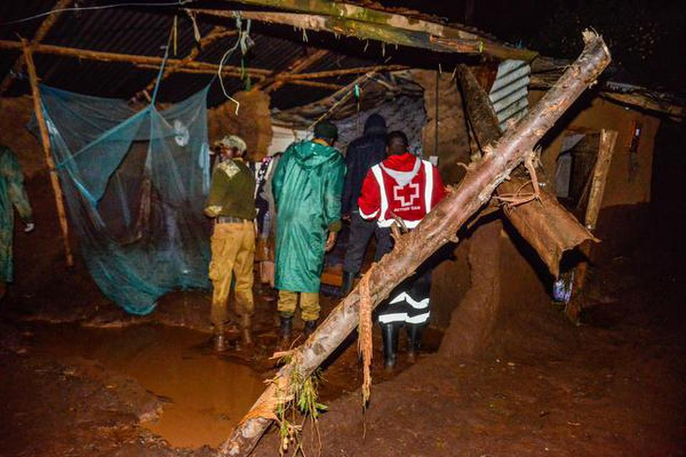 volunteers scour for survivors in a residential area on May 10, 2018 after a dam burst its bank at Solai, about 40 kilometres north of Nakuru, Kenya. So far, 20 bodies have been recovered.   | Photo Credit: AFP