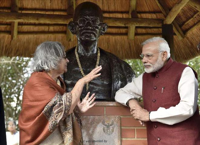 Prime Minister Narendra Modi talks with Ela Gandhi, granddaughter of Mahatma Gandhi during his visit to Phoenix Settlement in Durban, South Africa in this file photo.