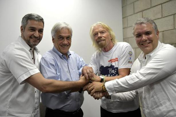 "Paraguay's President Mario Abdo Benitez, Chile's President Sebastian Pinera, Richard Branson and Colombia's President Ivan Duque, attends the ""Venezuela Live Aid"" concert at the Tienditas cross-border bridge between Colombia and Venezuela, in Cucuta, Colombia on Friday."