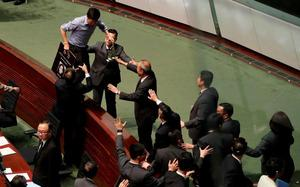 Hong Kong legislative session adjourned amid protests and heckling