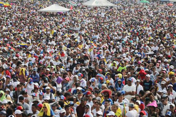 "People attend the ""Venezuela Live Aid"" concert at the Tienditas cross-border bridge between Colombia and Venezuela, in Cucuta, Colombia, on Friday."
