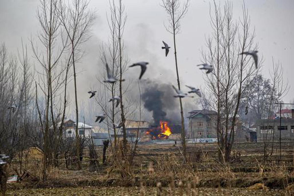 Flames and smoke billow from a residential building where militants are suspected to have taken refuge during a gun battle in Pulwama, south of Srinagar, Indian controlled Kashmir, Feb. 18, 2019. The image was part of a series of photographs by Associated Press photographers which won the 2020 Pulitzer Prize for Feature Photography