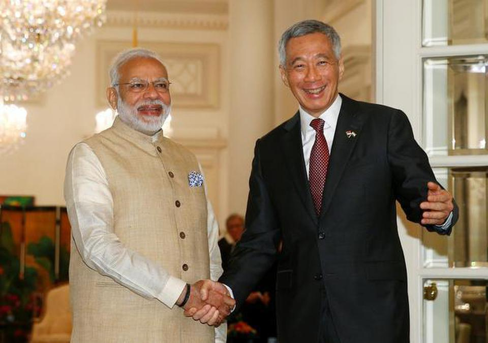 India's Prime Minister Narendra Modi meets with Singapore's Prime Minister Lee Hsien Loong at the Istana in Singapore on Friday. REUTERS/Edgar Su
