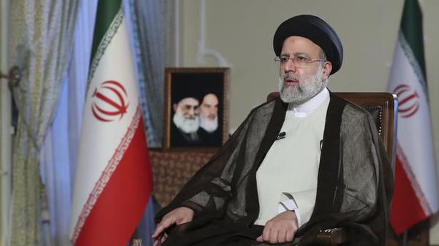 Iran says U.S. should lift sanctions to prove it wants talks
