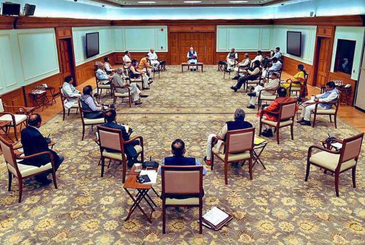 Prime Minister Narendra Modi chairs a cabinet meeting as ministers maintain social distancing.