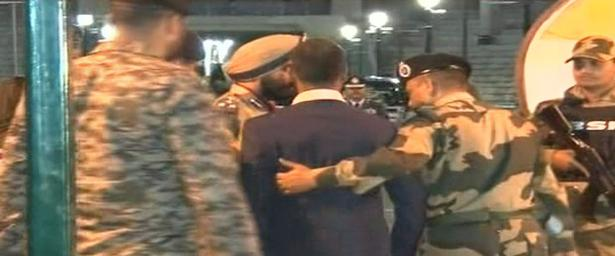 BSF officials receive IAF pilot Wing Commander Abhinandan Varthaman as he arrives at Attari border on the Indian side on Friday.