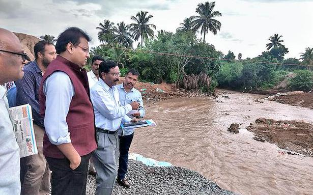 Collector inspects rain-hit roads