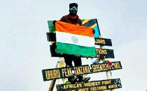 Tribal youth scales Mt. Kilimanjaro