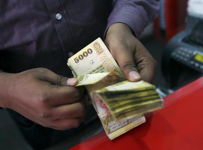 Down Memory Lane A Man Counts Sri Lankan Rus At Money Exchange Counter In