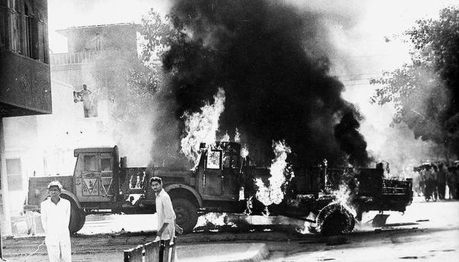 Playing with fire: Vehicles set on fire in a Sikh-inhabited area in Delhi in November 1984.