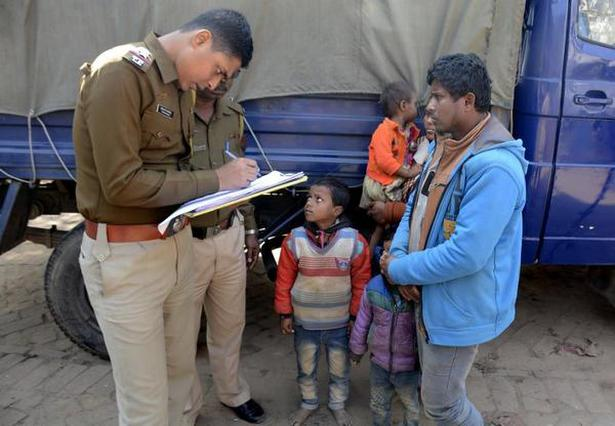 A policeman registers the names of Rohingya refugees after they were detained while crossing the India-Bangladesh border from Bangladesh, at Rayermura village on the outskirts of Tripura capital Agartala on January 22, 2019.