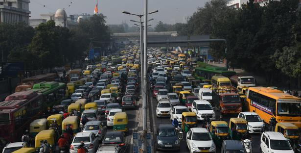 Traffic piled up in Vikas Marg which connects East side to New Delhi following traffic restrictions as farmers march to Parliament Street.