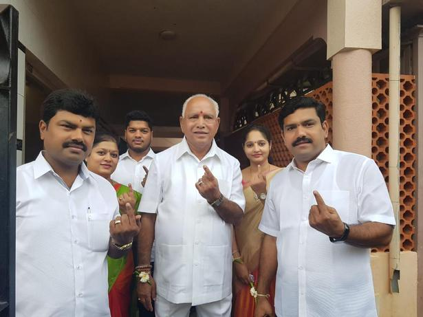 BJP State president B.S. Yeddyurappa and his sons — B.Y. Raghavendra and B.Y. Vijayendra — display their inked fingers after casting their votes during the by-election for Shivamogga parliamentary seat in Shikaripur, Karnataka on Saturday.