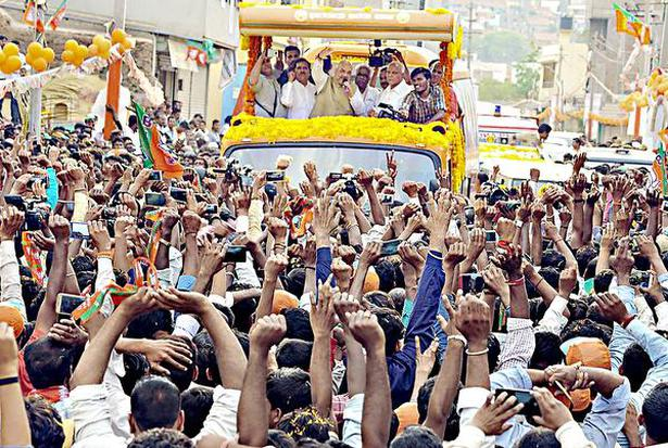 BJP president Amit Shah, along with State unit president B.S. Yeddyurappa and party leaders, taking part in a road show in Gokak during the sixth round of his visit to the poll-bound State on Friday.