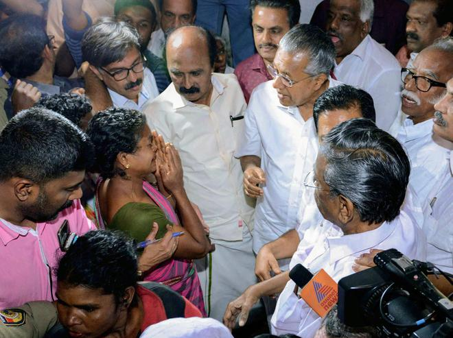 Image result for kerala chief minister and opposite party visit together to see flood affected areas