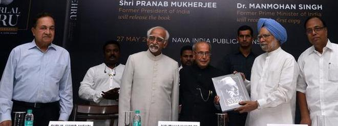 Illustrated biography: Former President Pranab Mukherjee, former Vice-President Hamid Ansari, former PM Manmohan Singh, N. Ram, Chairman of The Hindu Group of Publications, and author A. Gopanna at the launch of a book on Nehru in New Delhi on Sunday.