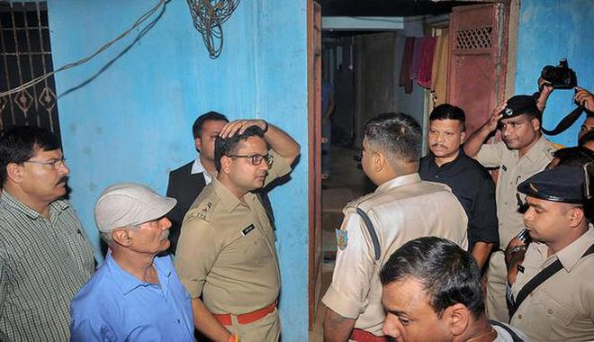 Police officers at the house in Ranchi on Monday where seven members of a family allegedly committed suicide.