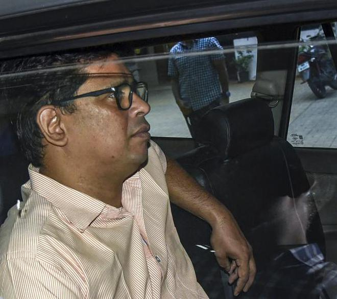 Activist Arun Ferreira is escorted from his Thane home after his arrest on October 26, 2018.