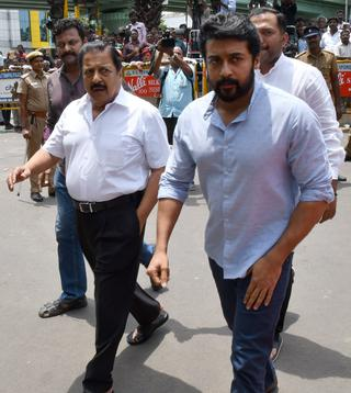 Actor Suriya and his father, actor Sivakumar, coming out of Kauvery Hospital in Chennai on Monday.