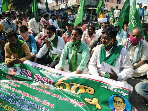 Adivasis staging a dharna under the aegis of the Adivasi Samkshema Parishath in protest against the Layout Regularisation Scheme (LRS) and the new Revenue Act in Bhadrachalam of Bhadradri-Kothagudem district on Monday.