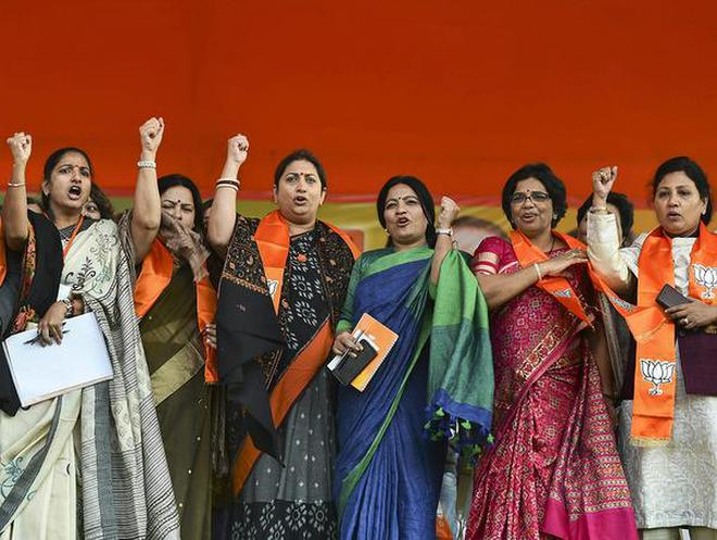 Calling attention : Union Minister Smriti Irani and party leaders at the 'Mahila Hunkar Rally' in New Delhi on Sunday.