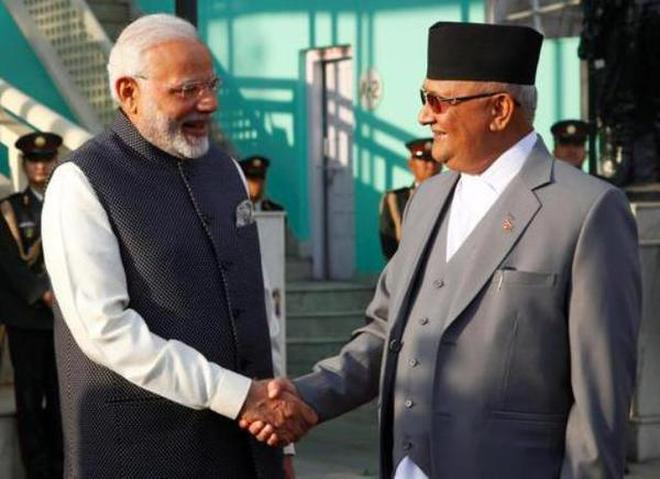India's Prime Minister Narendra Modi shakes hand with his Nepalese counterpart Khadga Prasad Sharma Oli, also known as K.P. Oli, after inspecting a guard of honour upon his arrival in Kathmandu.