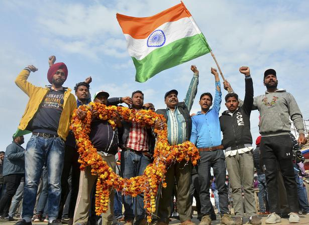People wait to welcome IAF pilot Abhinandan Varthaman at Wagah near Amritsar on March 1, 2019.