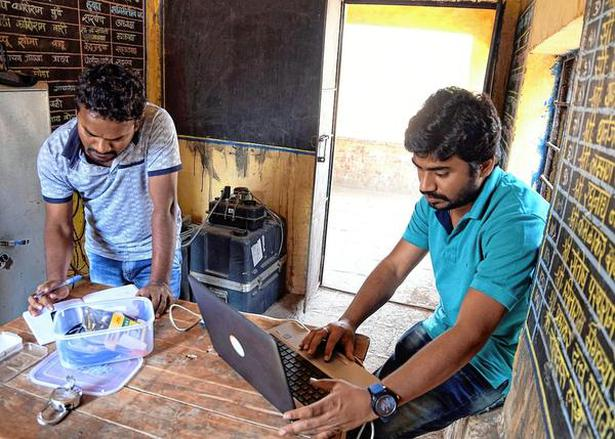 Mahesh Gollapudi and Dhiraj Kumar Singh, project assistants at Hyderabad's National Geophysical Research Institute, collect data from a seismometer in Gagodi village, Palghar.