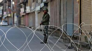 In Kashmir, shaking the apple tree