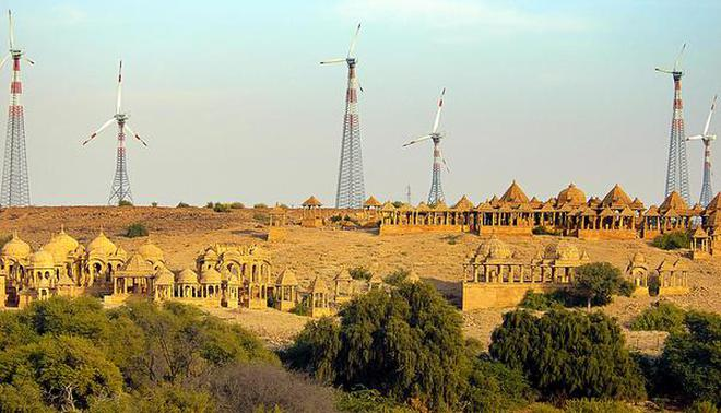 Dessert wildlife faces massive threats from solar and wind farms the windmills from the royal cenotaphs at jaisalmer rajasthan fandeluxe Choice Image