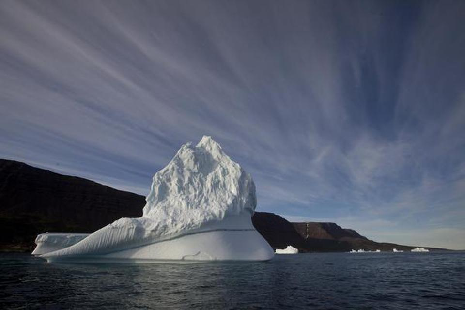 An iceberg floats in the sea near Qeqertarsuaq, Disko Island, Greenland.