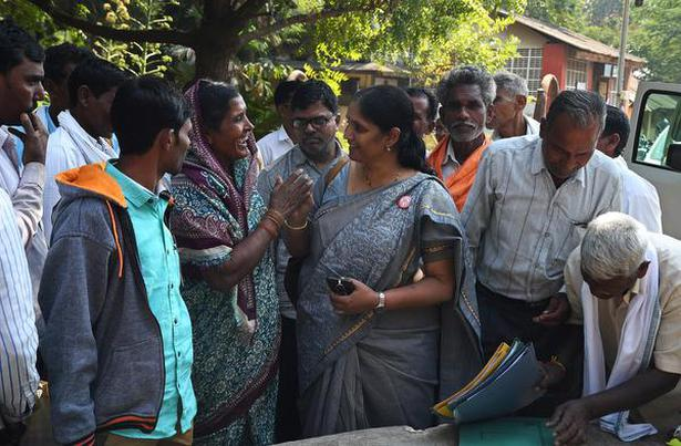 Paromita Goswami with villagers at the district collector's office. Photo: Arunangsu Roy Chowdhury