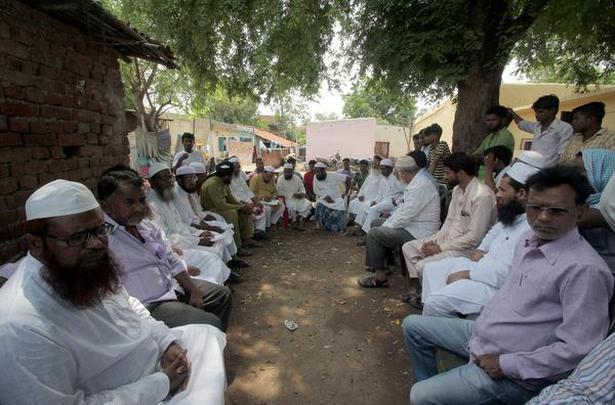 Social workers and Muslim leaders meet at Ansari's home in Kadamdia village after the lynching. Photo: Biswaranjan Rout