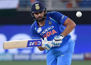 Seizing his chances: Rohit Sharma cashed in on dropped catches to make a fluent, unbeaten century.