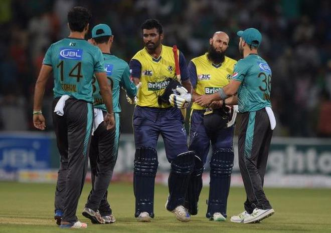 Amla perera power world xi to 7 wicket win vs pakistan the hindu world xi batsmen hashim amla and thisara perera shake hand with pakistani cricketers at the end of the second twenty20 international cricket match at the fandeluxe PDF