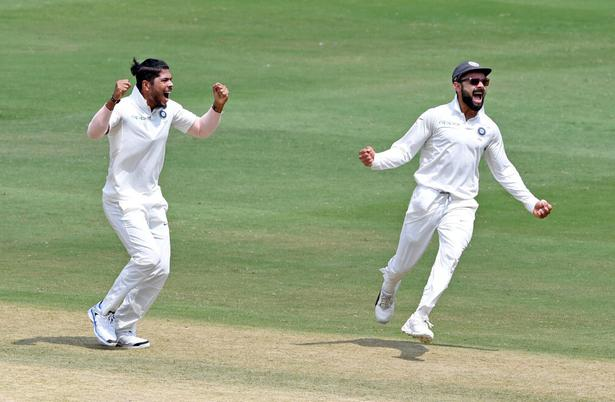 Umesh Yadav celebrates the wicket of Kraigg Brathwaite on day 3 of the second Test against West Indies in Hyderabad on October 14, 2018.