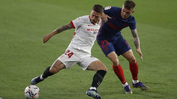 Atletico's title bid falters again with loss at Sevilla