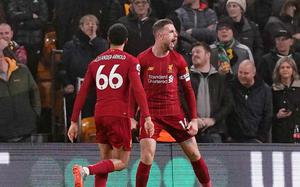 Liverpool charge towards Premier League title with win at Wolves