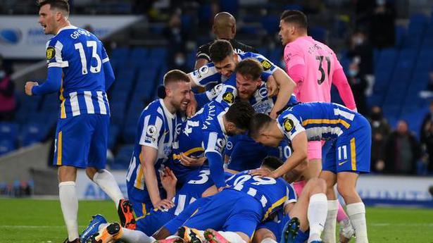 10-man Manchester City loses 3-2 at Brighton, Gundogan off injured