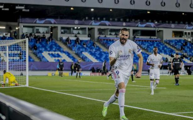 Benzema's double propels Real Madrid into last 16