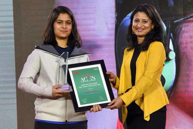 Bull's eye: The 16-year-old Manu Bhaker receives her award from ace shooter Anjali Bhagwat.