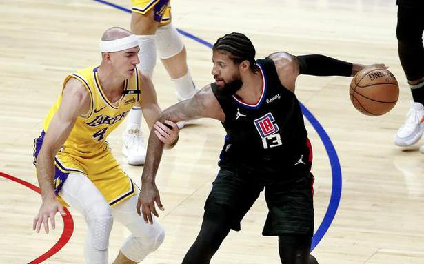 George helps Clippers sweep LA derby