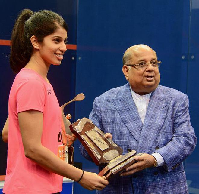 Rich collection: Joshna Chinappa, who equalled the 16 titles of Bhuvaneswari Kumari, receives the trophy from N. Ramachandran on Sunday.