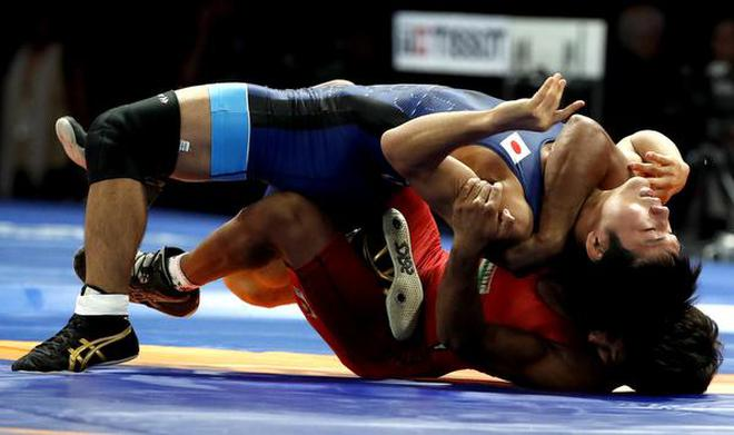 India's Bajrang Punia (in red) in action against Japan's Daichi Takatani in the 65 kg men's freestyle wrestling final match at the Asian Games 2018 in Jakarta on August 19, 2018.