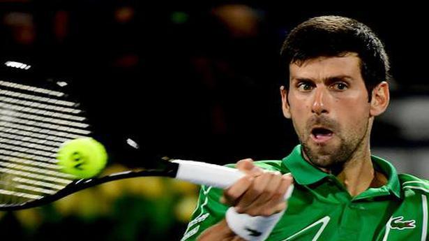 Djokovic sets up Dubai semifinal against Monfils