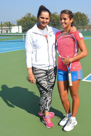Two-time Grand Slam winner Sania Mirza sharing a lighter moment with Ankita Raina during the Fed Cup camp at Sania Mirza Tennis Academy in Hyderabad in 2013.
