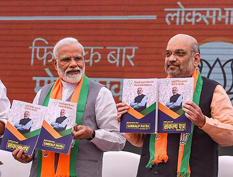 PM Modi and BJP president Amit Shah release the party's manifesto on Monday. PTI PTI
