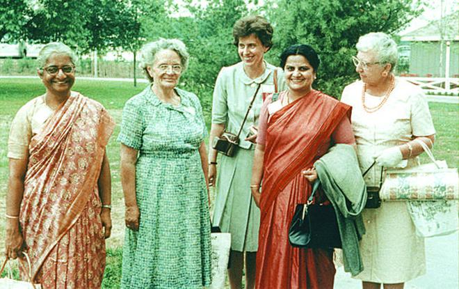Attendees gather at the 1964 New York World's Fair during the First International Conference of Women Engineers and Scientists, hosted by the Society of Women Engineers in June 1964. Left to right: A. Lalitha (Indian delegate), unknown, Joan Shubert, unknown Canadian delegate, N. Sainani (Canadian delegate of Indian origin), and Dee Halladay.