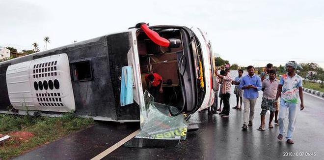 A capsized bus at Kallupatti on Tiruchi-Madurai highway.