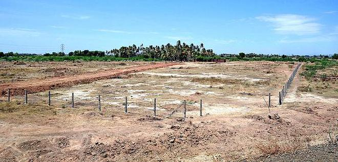 A fence has come up at the site identified for establishment of a permanent trade centre at Panjapur on the outskirts of Tiruchi.M. MoorthyM_Moorthy